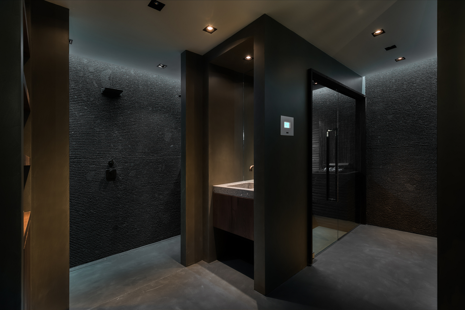 black mosaic and floor heated natural stone shower room with sauna.