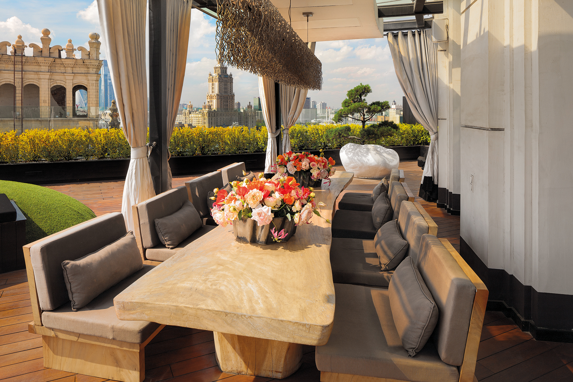 Rooftop garden outdoor dining table overlooking Moscow city centre