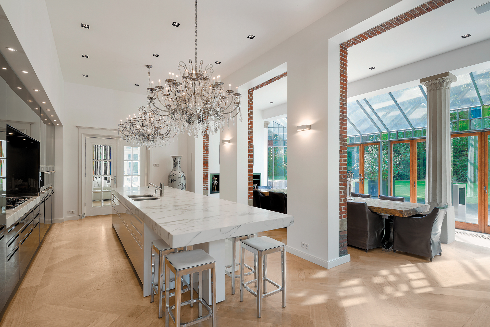 Kitchen island with dining foyer in the back