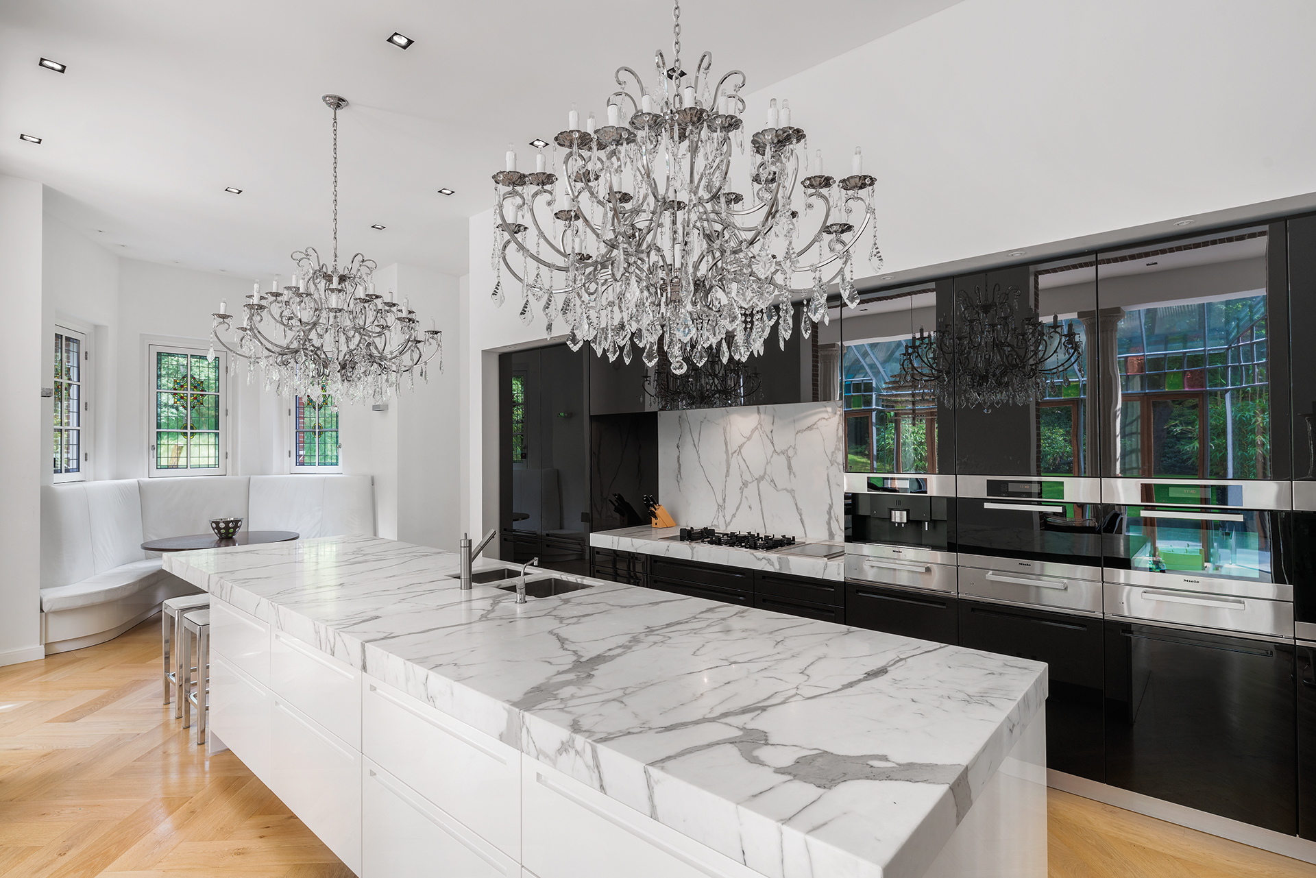 Marble top kitchen island with chandalier and dining corner