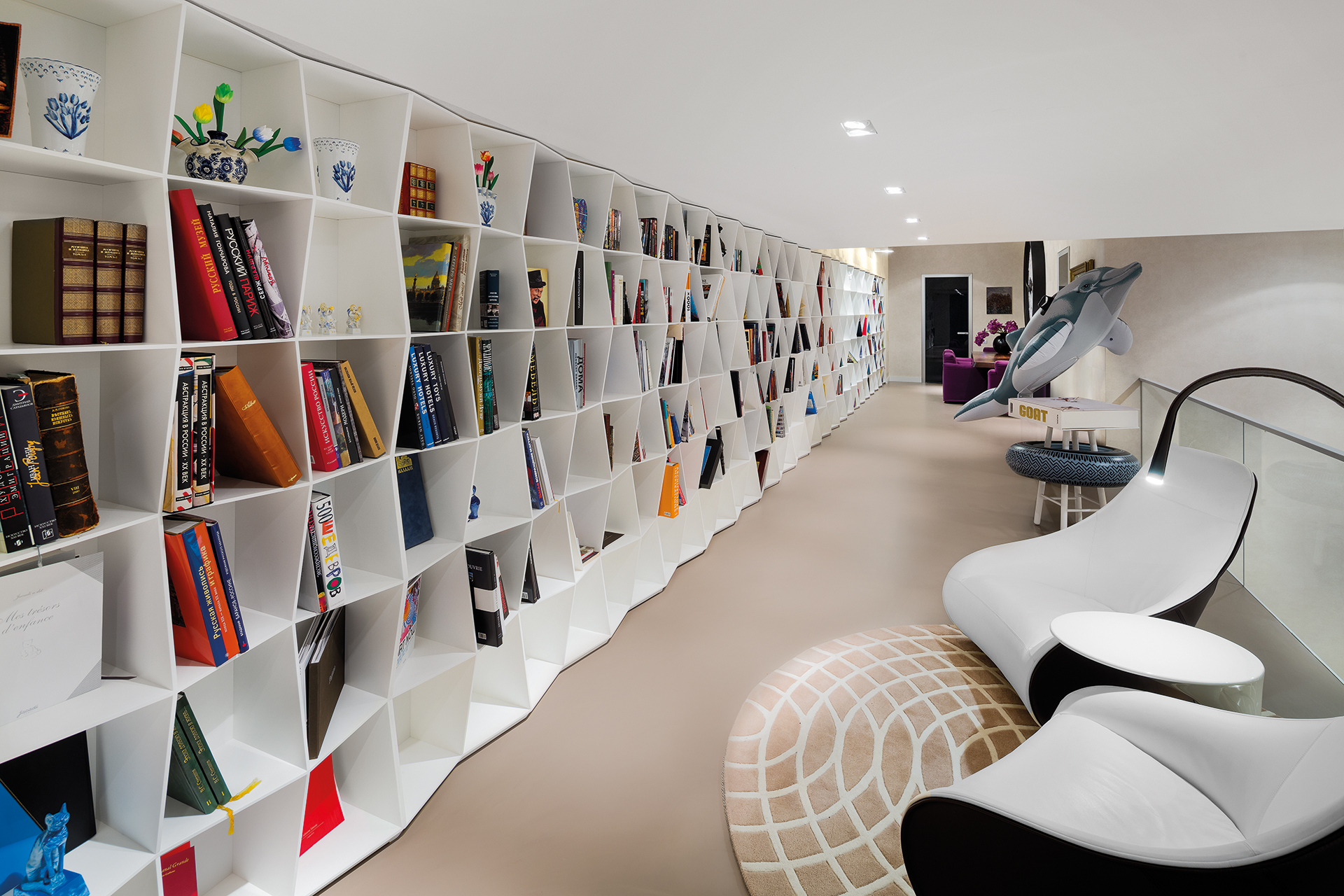 upper walkway with design bookshelves forming a massive personal library