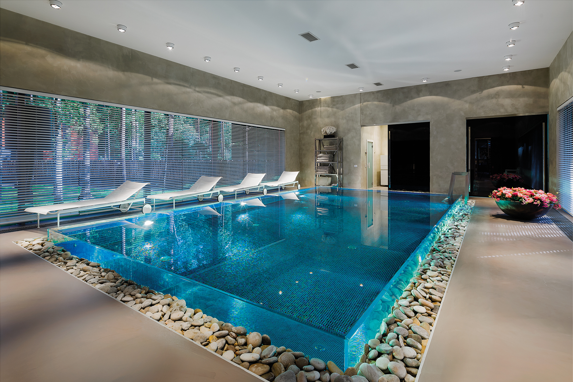 raised pool in a strong clear acryllic tub surrounded by person high windows with shutters