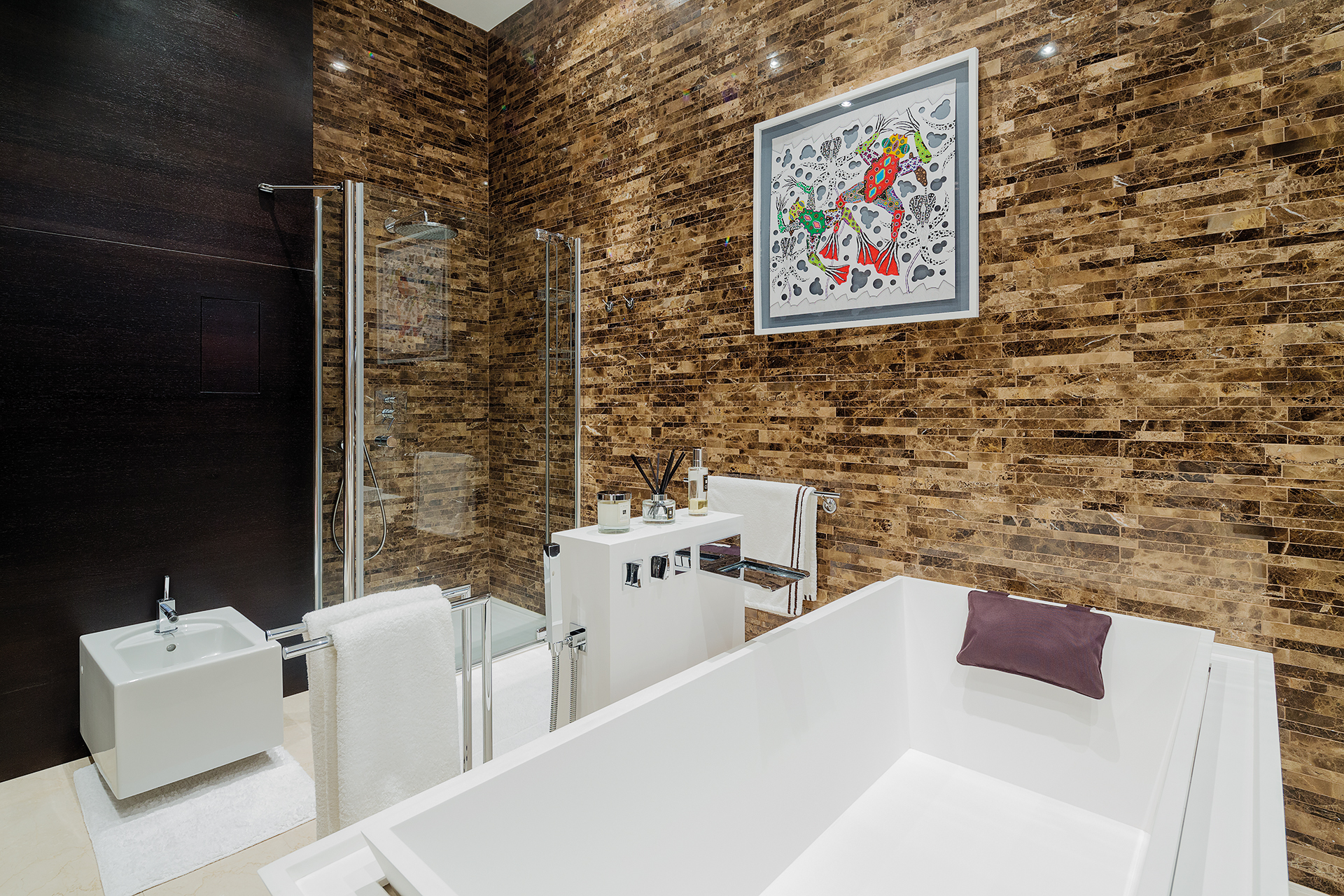 Bathroom with offset brick tiles including a bath, bidet and shower
