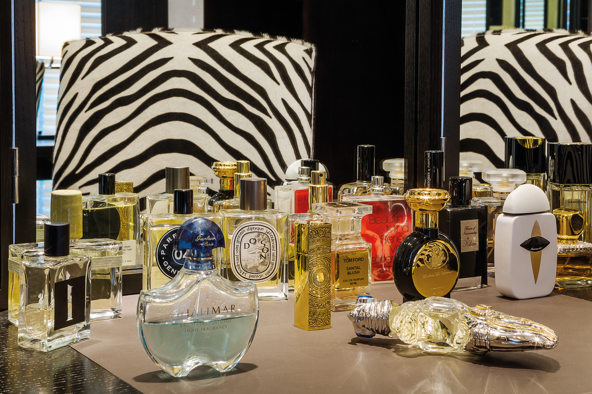 Perfumes lined up at the make-up desk