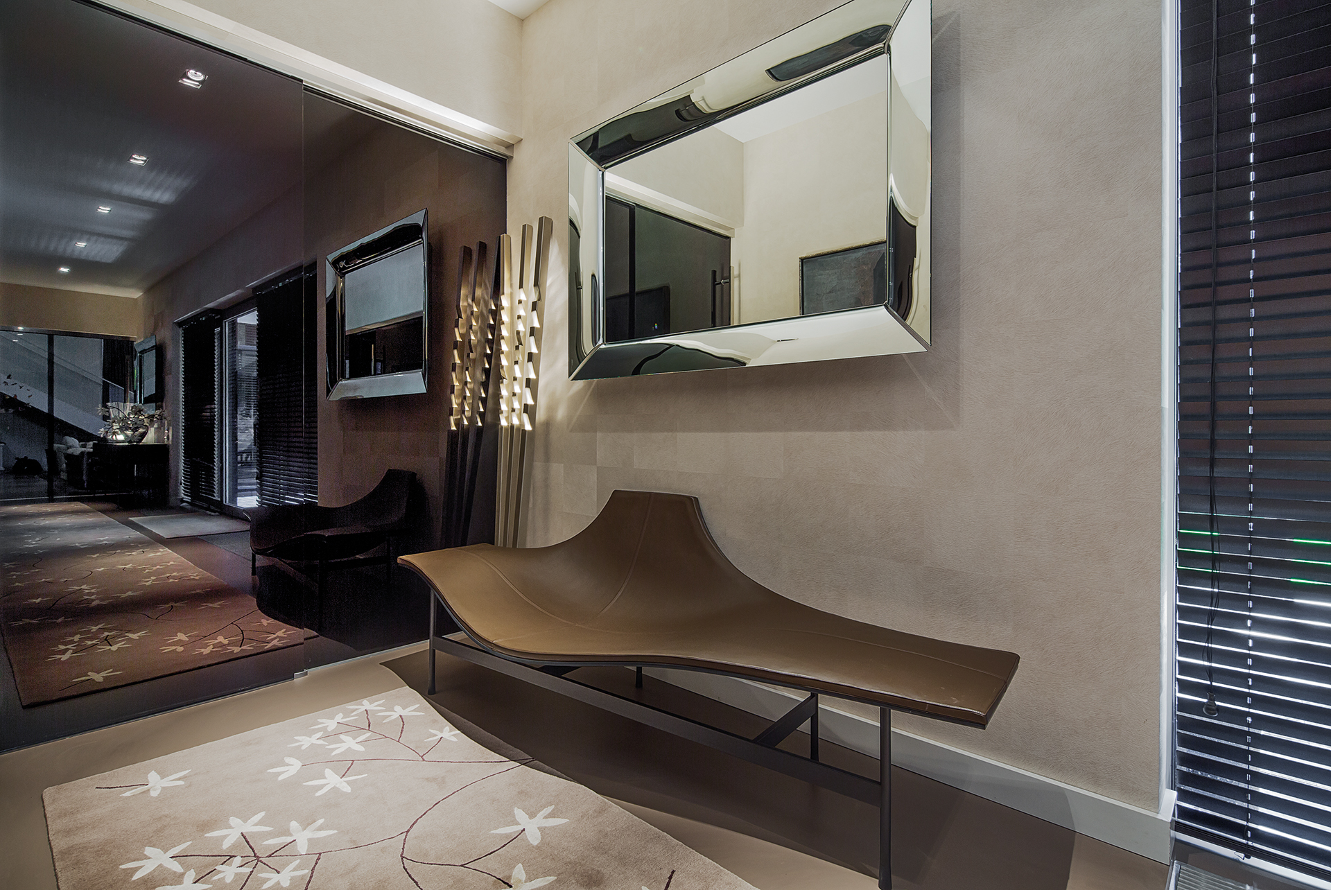 Hallway with mirrored sliding doors and a designer bench for an easy seat before going outside