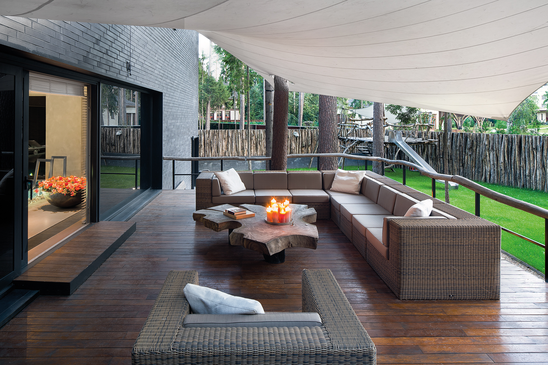 backyard terrace furnished around a large tree trunk table