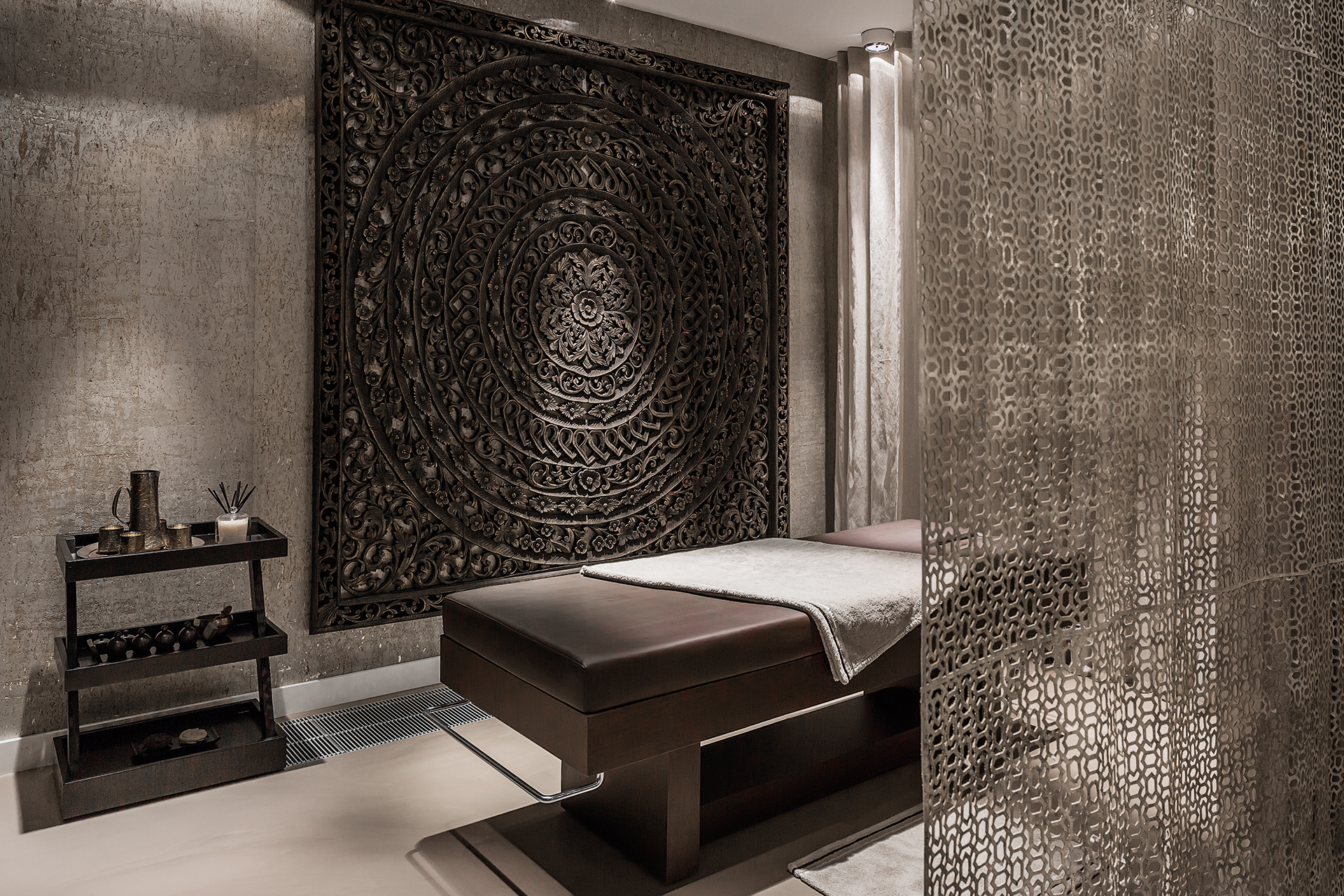 Massage parlor with grate separator and beautiful Indian style wall decoration