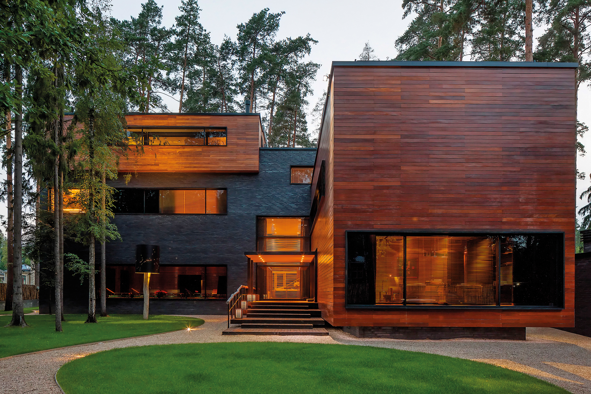 Exterior grounds of the shukovka house cuboid in appearance with wood and blackstone finish