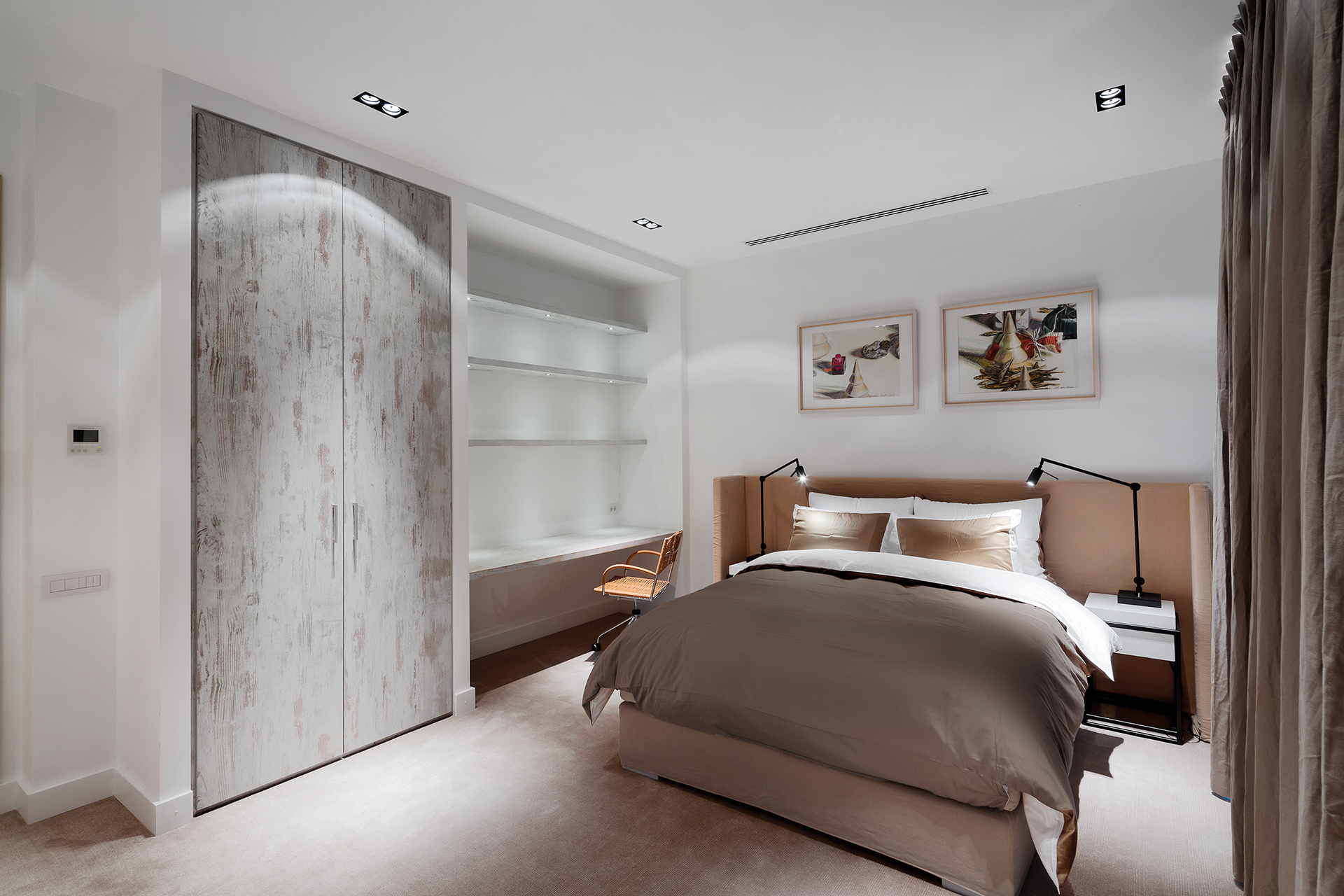 Guestroom bed in beige with working desk and closet space