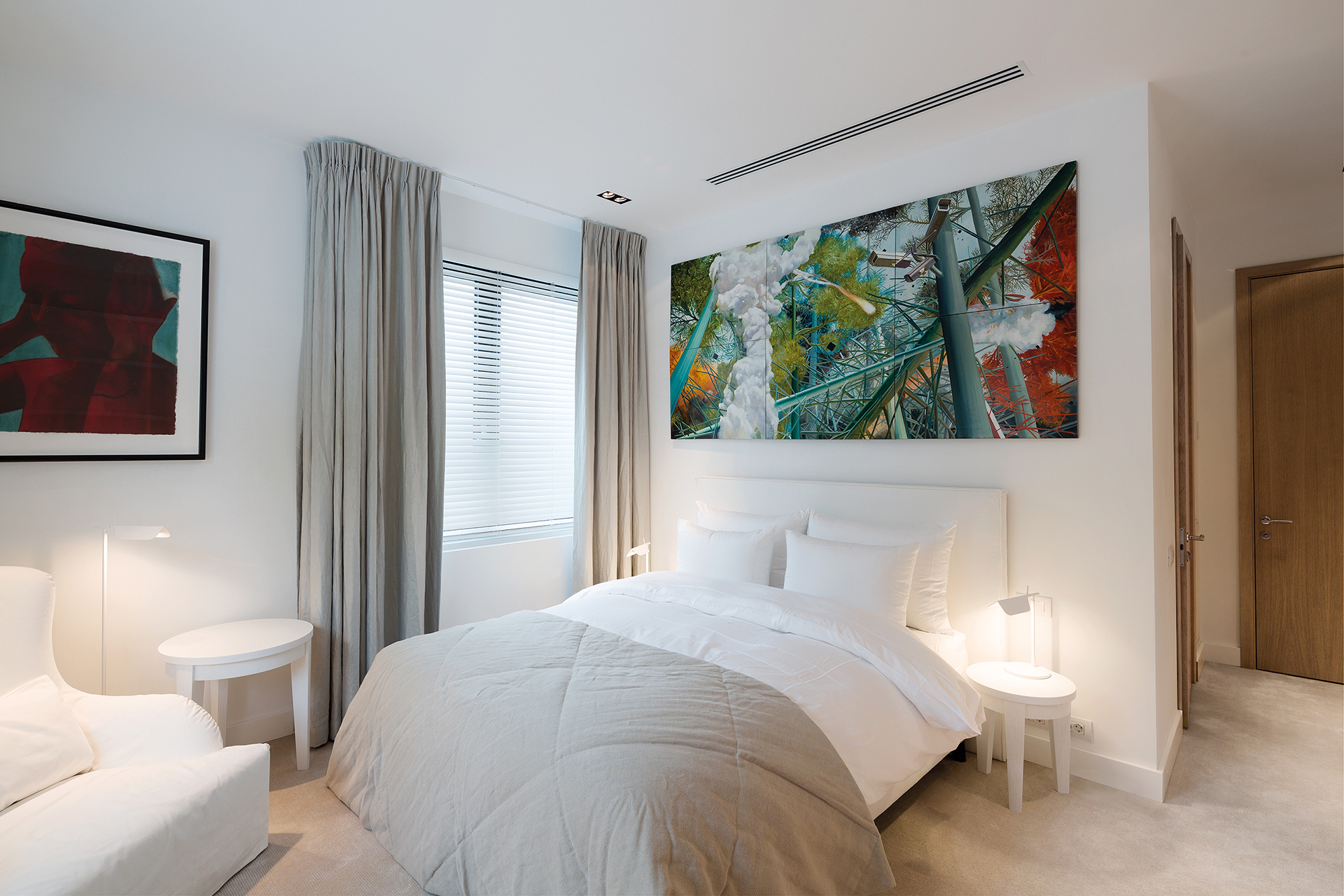 comfortable guestroom in white with art