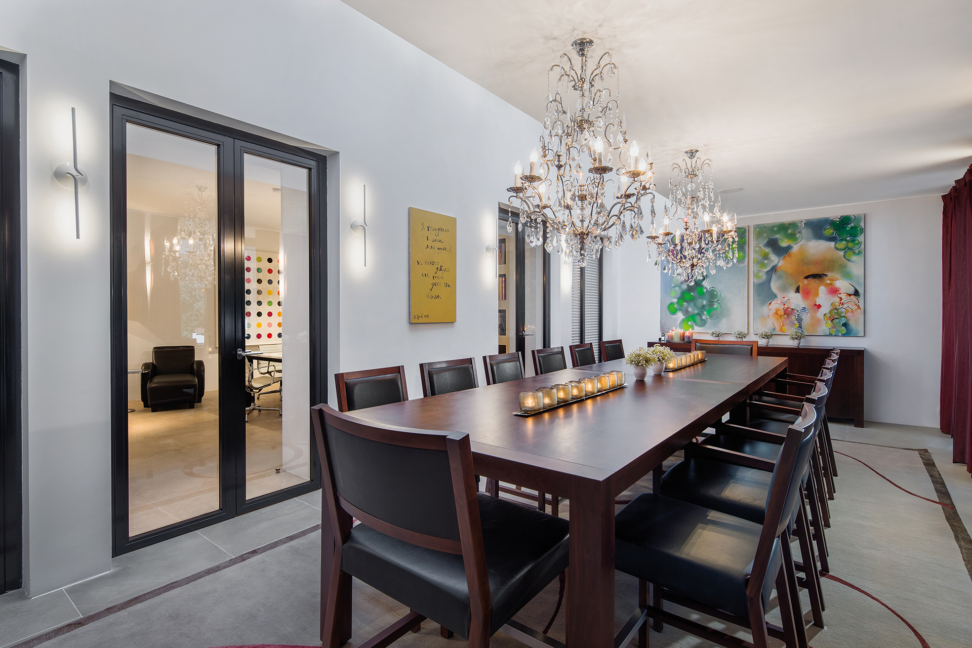 Indoor dining area with white walls and chandeliers