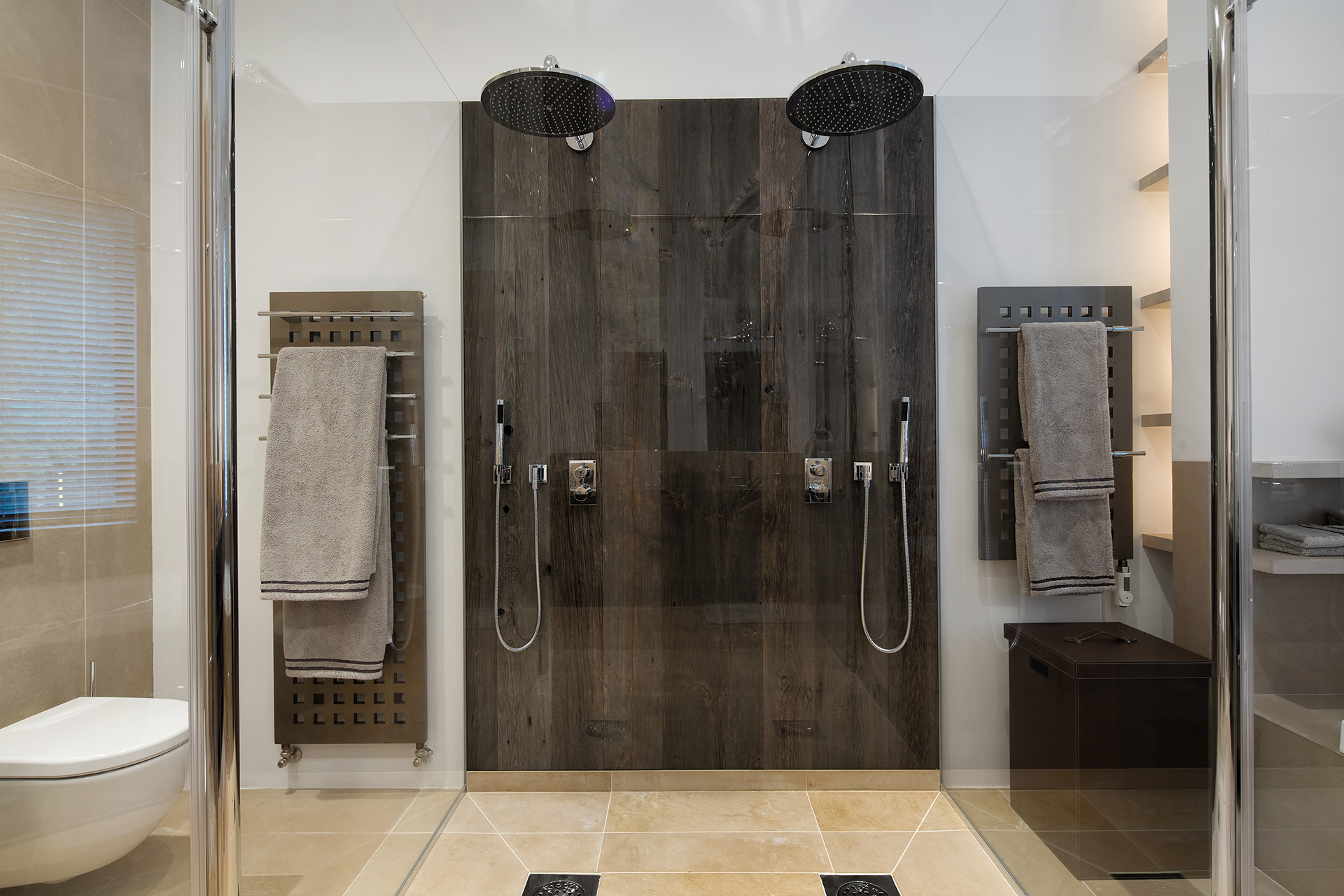 Double rain shower in glass cubicle