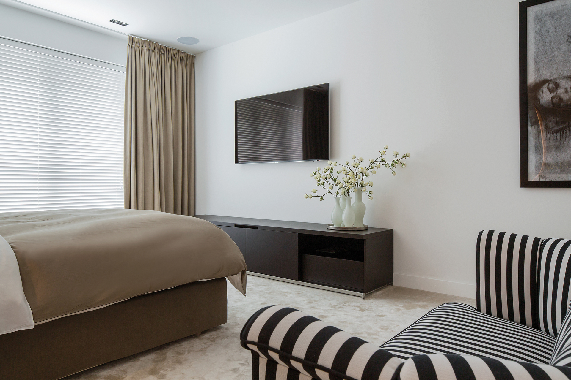 Guestroom with bed storage and television