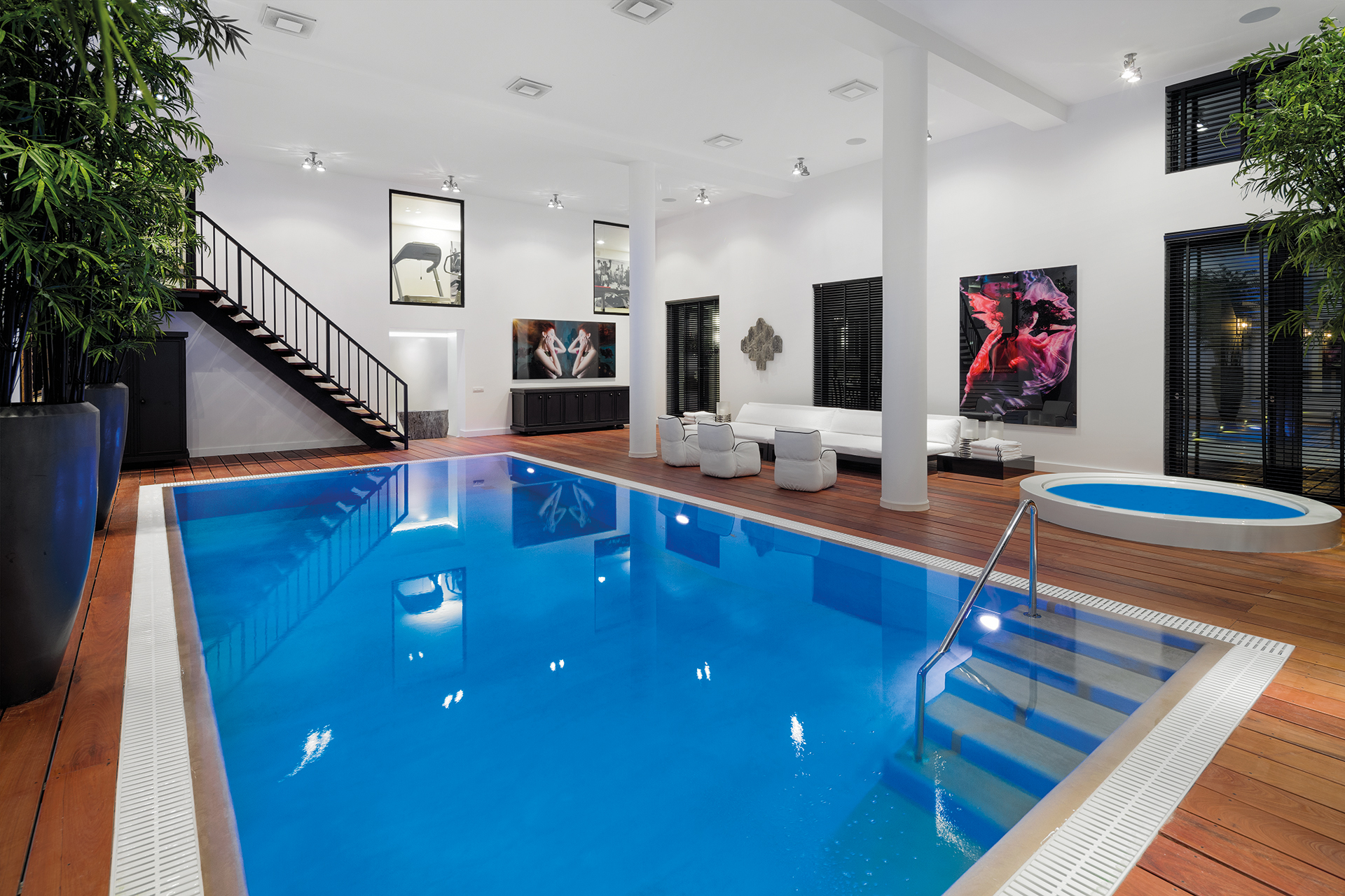 Indoor pool with lounge area and Jacuzzi