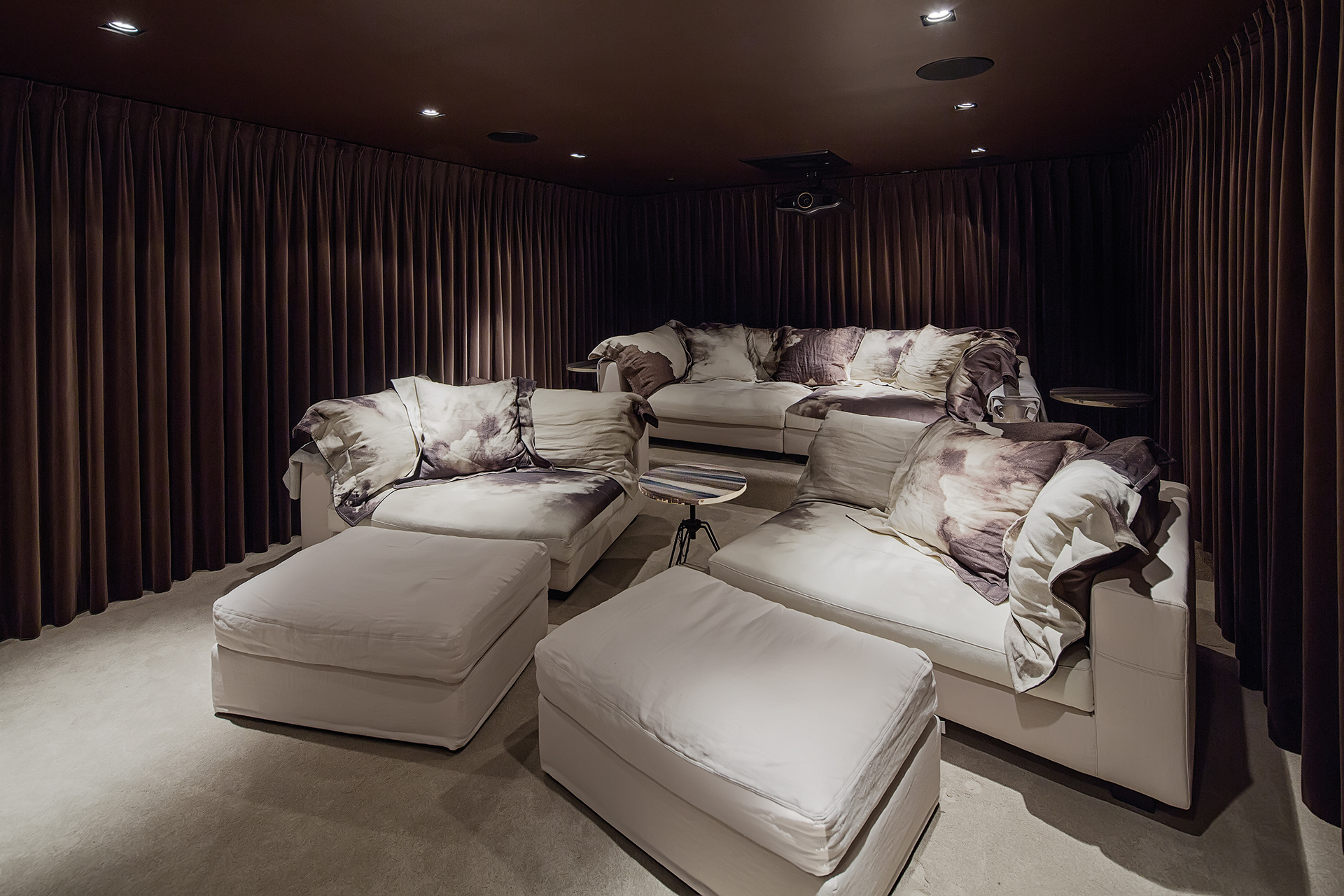 comfotable home cinema with multiple sofas and blankets