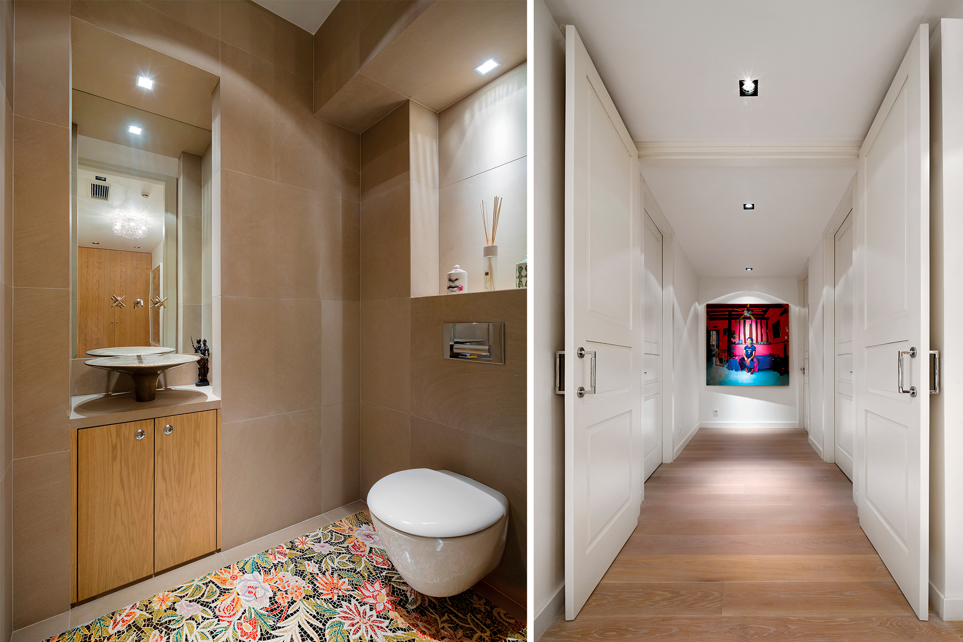 bathroom with floral mosiac floor and a long hallway flanked by white wood doors and panels