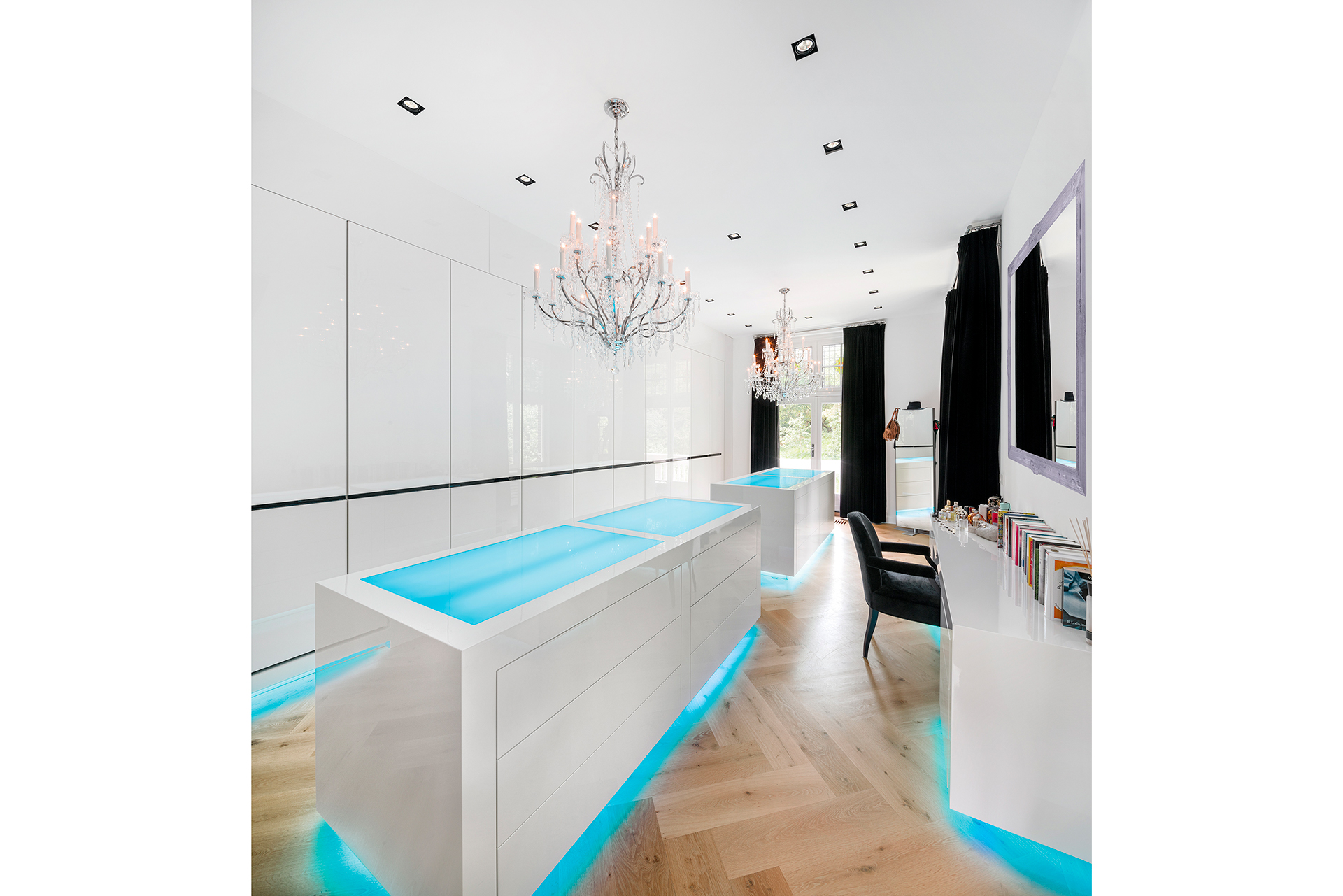 modern wardrobe with sleek white glossy closets and led underlighting