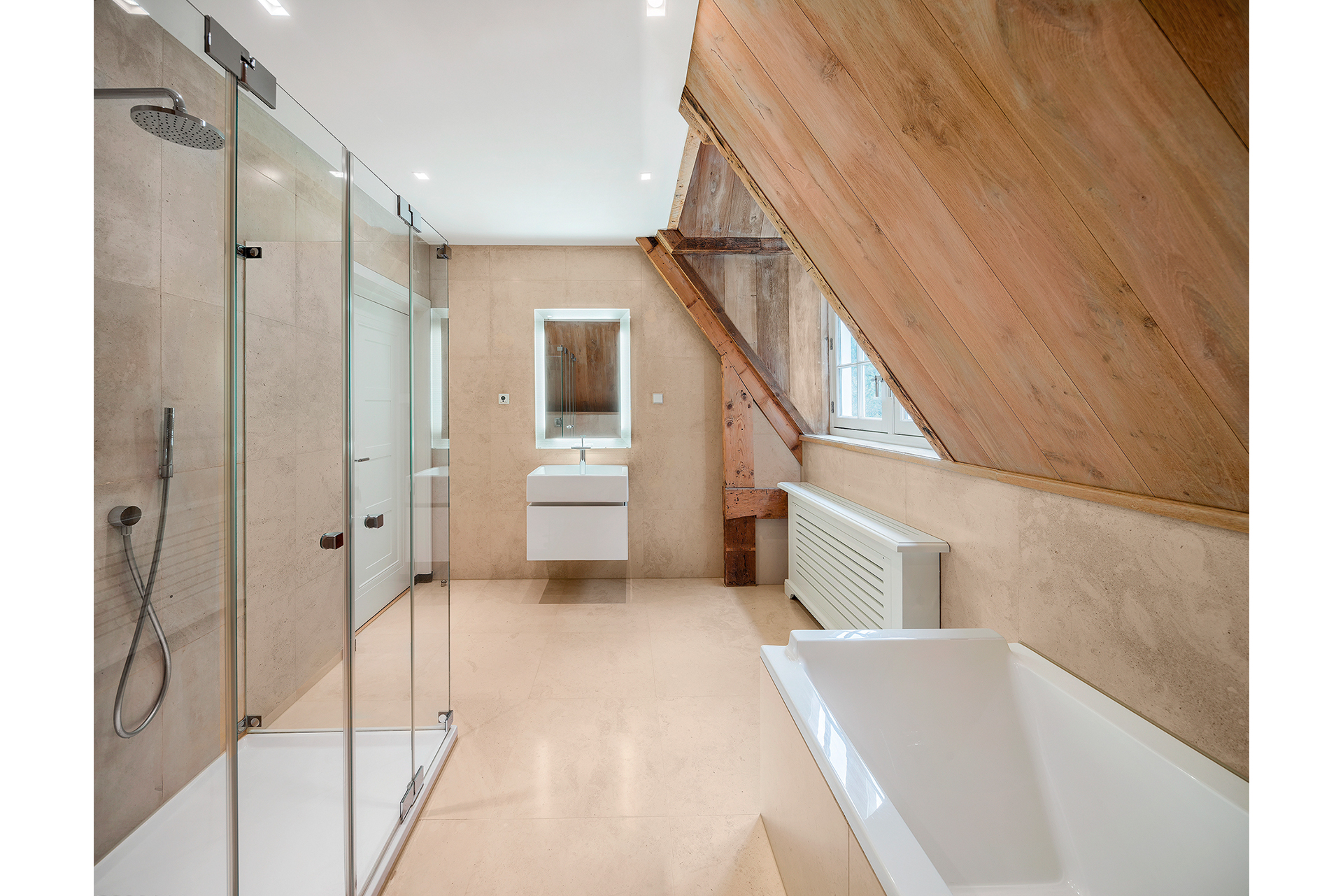 Extra bathroom with cast tan floor under a sloped roof