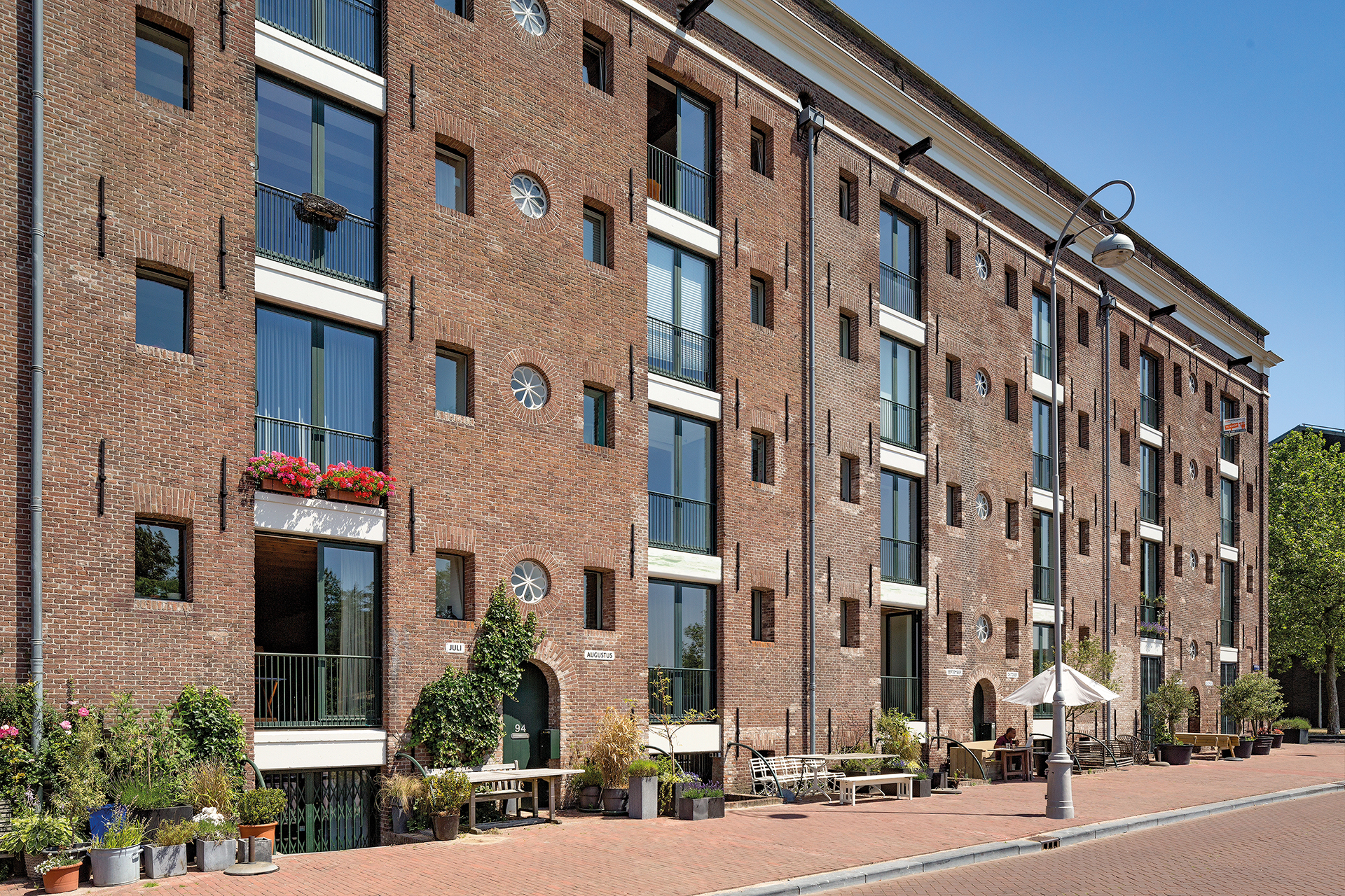 Historical amsterdam warehouse renovated into modern apartment building